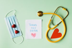 thank you doctor note next to a face mask and a stethoscope 4386489 300x200